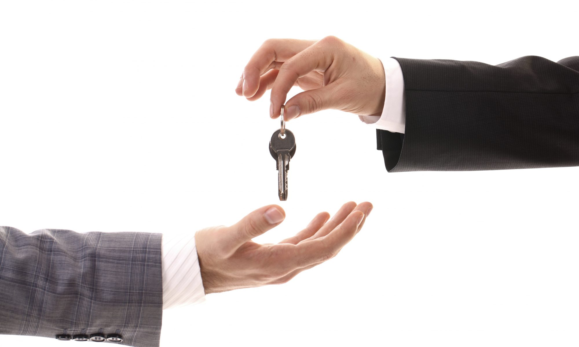 first time home-buyers mage with key being passed
